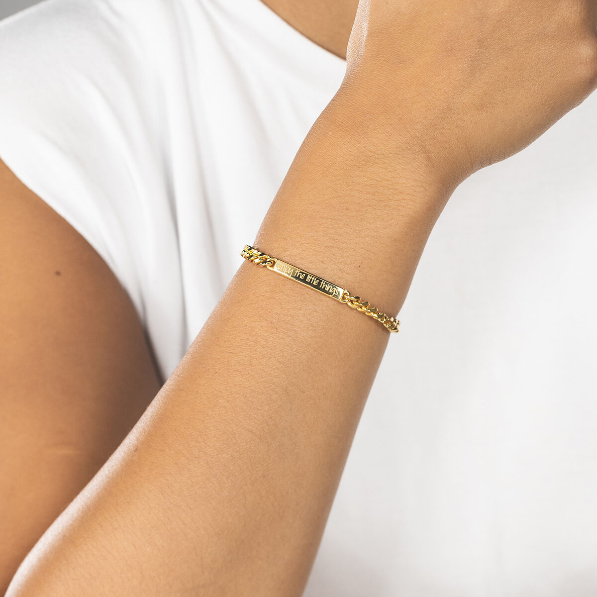 Bold bracelet gold text model